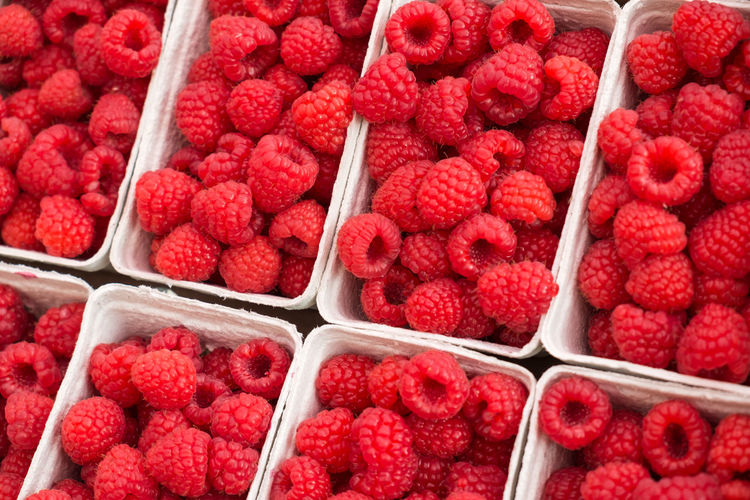 Raspberries in cardboard box Market Raspberries Abundance Background Berry Berry Fruit Bowl Cardboard Close-up Consumerism Food For Sale Freshness Fruit Fruits Heap Large Group Of Objects Raspberry Red Retail  Ripe Supermarket Sweet Fruit