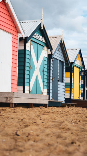 Beach huts against sky brighton beach huts