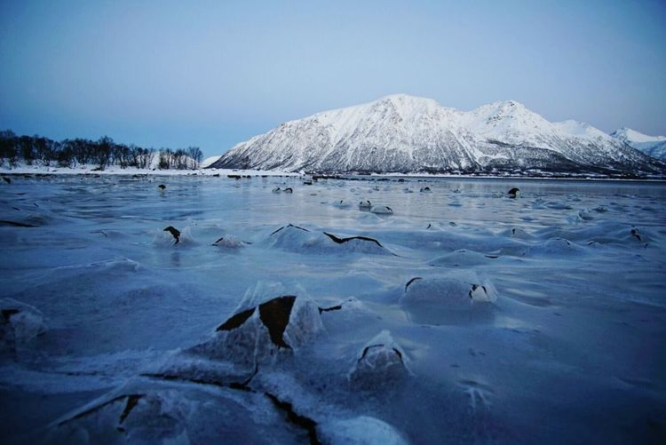 Scenic view of frozen lake against clear sky