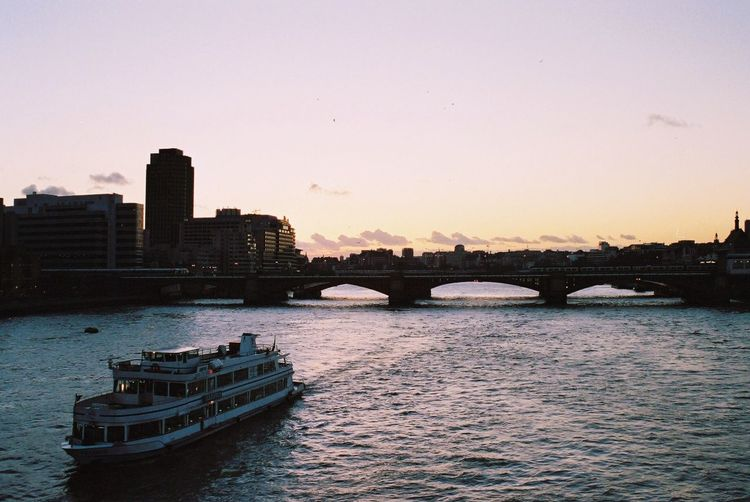 High Angle View Of Ferry Boat Sailing In Thames River During Sunset