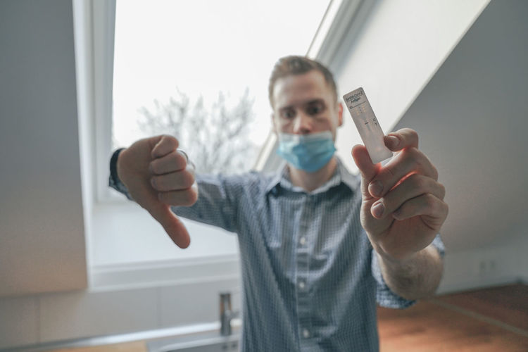 Man holding drug while gesturing