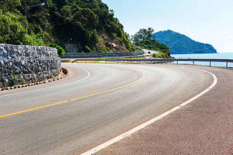 Surface Level Of Empty Road Against Calm Sea