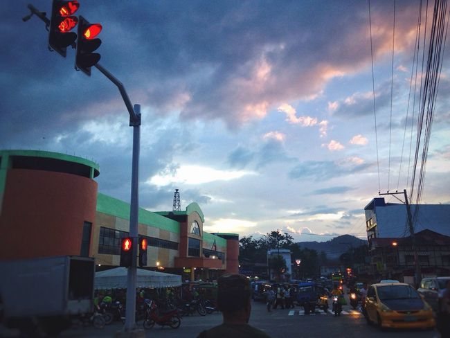 Sky Street Light Street Building Exterior Lighting Equipment Real People Road Clouds & Sky Illuminated Street Photography Sunset And Clouds  Mobile Photography IMography Eyeem Philippines Power Lines Busy Streets Streetlife