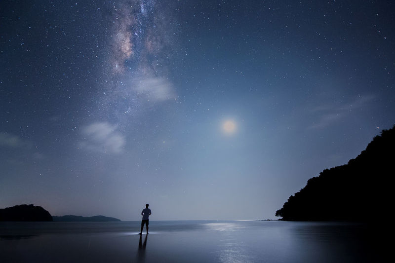 milky way and moon Astronomy Beauty In Nature Galaxy Nature Night One Person Outdoors People Real People Scenics Sea Silhouette Sky Standing Star - Space Tranquil Scene Tranquility Water