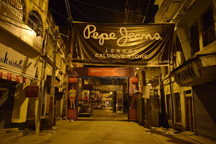 Road in the Night... Old Town with Modern Brand. TakeoverContrast Overnight Success Street Photography Street Night Architecture Built Structure The Way Forward Building Exterior Non-western Script Street Illuminated Road Night City Street Diminishing Perspective Outdoors Narrow Night Shop Brand Brand Pepe Jeans Market at Berhampore India