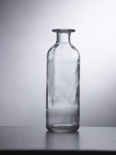 Close-up of empty glass bottle on table