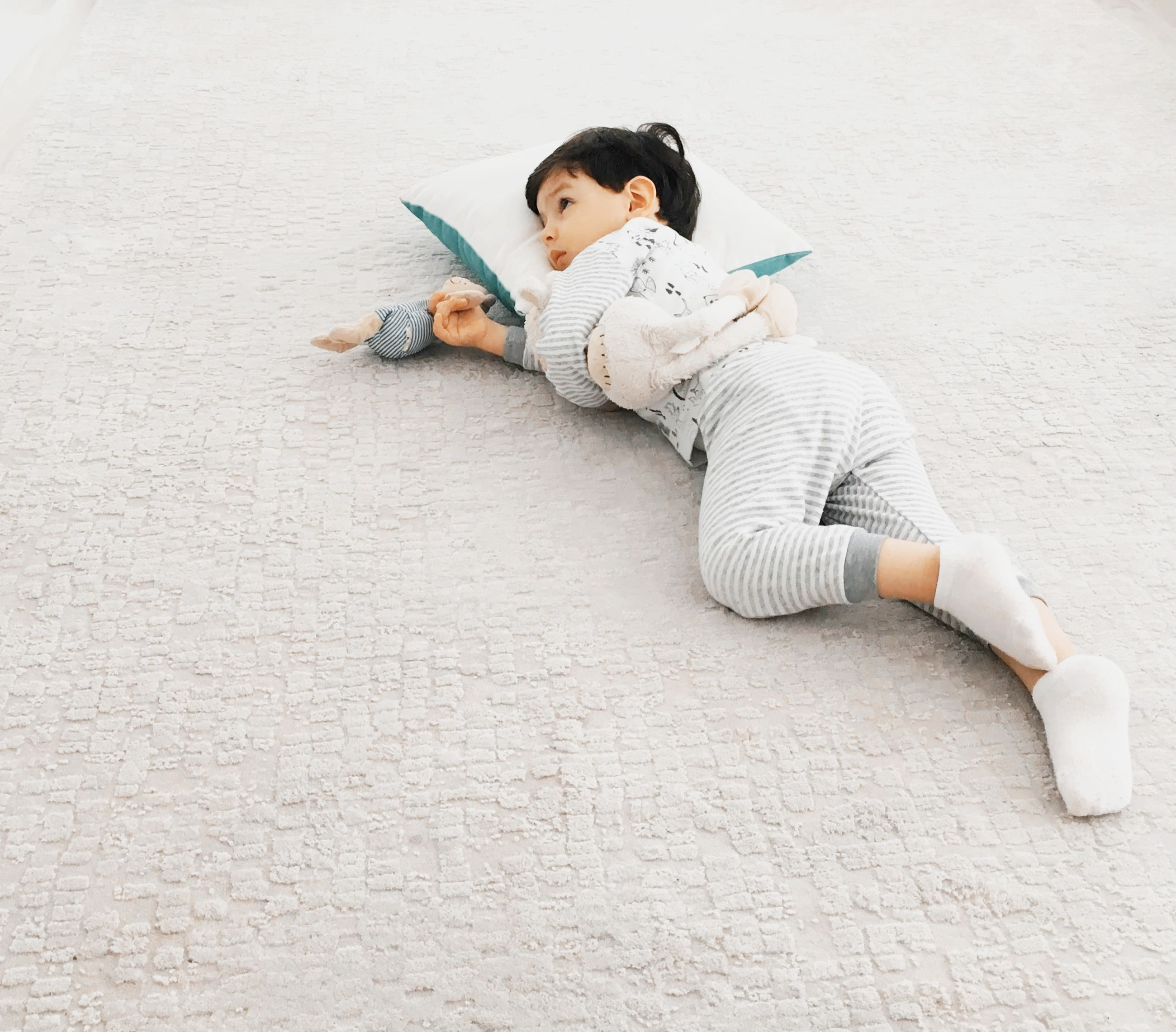 one person, full length, white, relaxation, lying down, women, adult, childhood, high angle view, copy space, indoors, child, casual clothing, lifestyles, young adult, sitting, female, person, leisure activity, reading, toddler, activity, clothing, publication