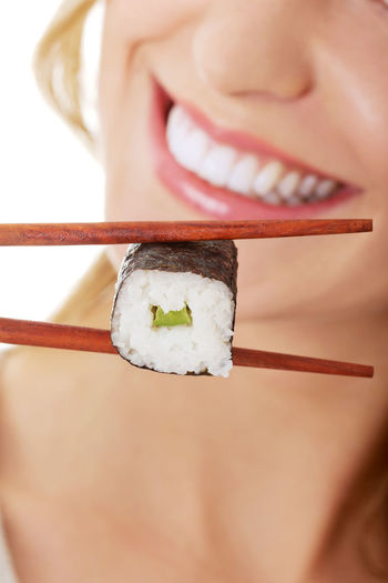 Midsection Of Woman Having Sushi
