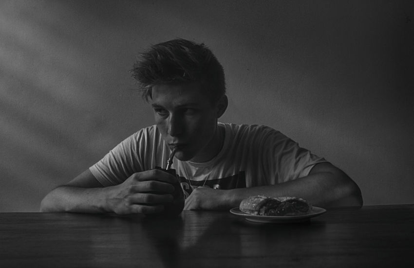 Taste of the moment B&W Portrait Black And White Boy Breakfast Calm Daily Life Day Face Groove Kitchen Leisure Activity Lifestyles Man Morning Portrait Quiet Moments Rays Relaxation Sadness Table Taste Yerba Mate Young Autoportrait