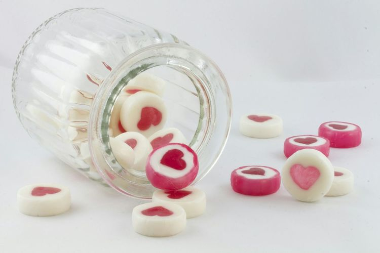 Close-Up Of Jar Spread Out Candies