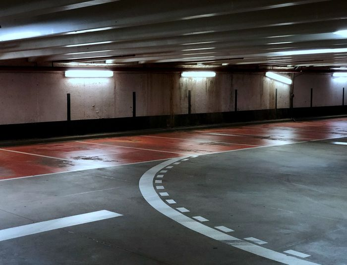 Pretty, dirty car park #urbanana: The Urban Playground EyeEmNewHere Lonely Underground Anybody Home? Architecture Ceiling Concrete DeGenerate Empty Flooring Grey Illuminated Indoors  Light No People Parking Garage Parking Lot Red And White Road Marking Shabby
