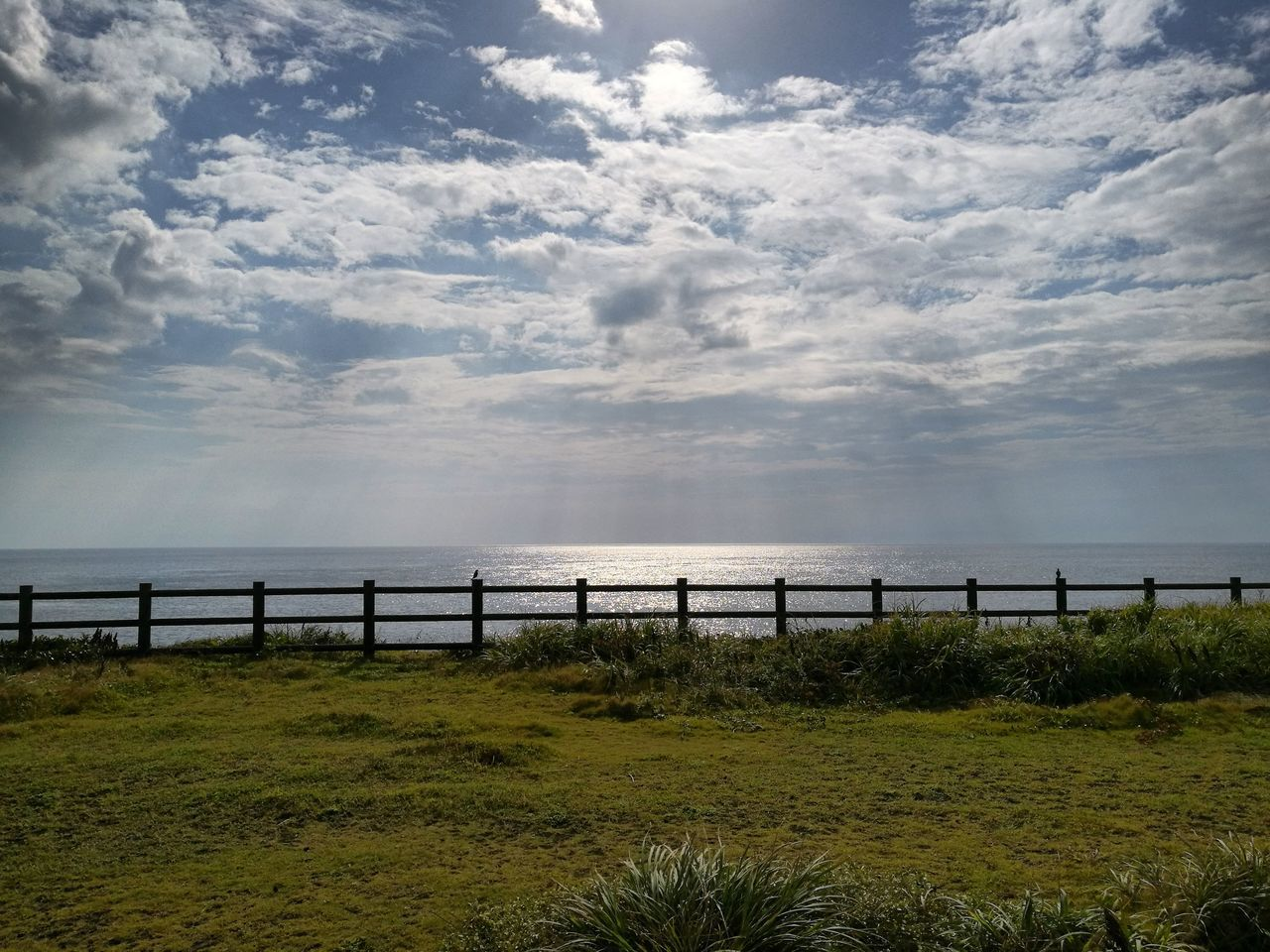 sea, cloud - sky, sky, no people, outdoors, scenics, nature, day, tranquil scene, grass, tranquility, horizon over water, water, beauty in nature