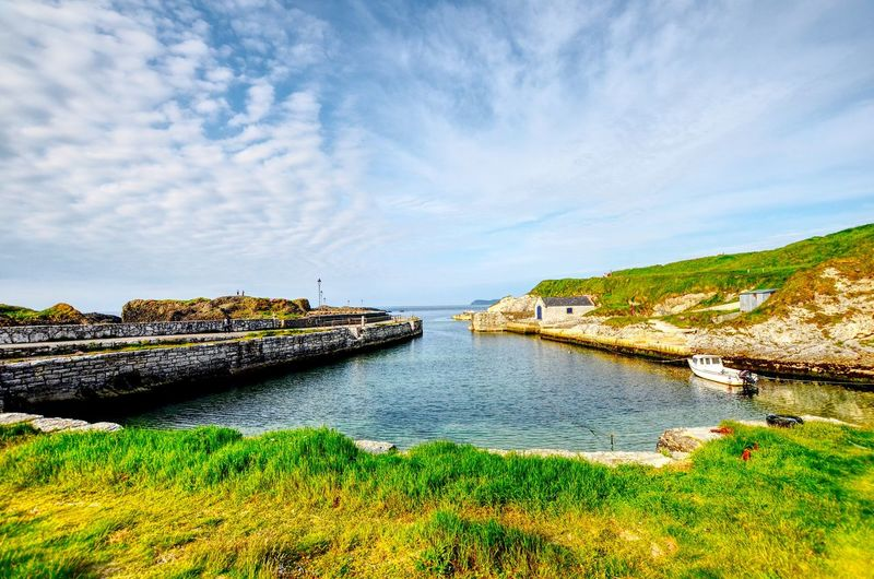 Ballintoy Harbour Game Of Thrones Location Ballintoy Harbour Harbour Water Sky Plant Cloud - Sky Beauty In Nature Scenics - Nature Nature Day Tranquility No People Land Tranquil Scene Grass Sea Green Color Outdoors Non-urban Scene