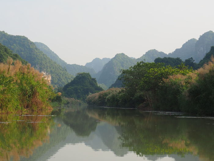 'The inland Ha Long Bay' Tam Coc Clear Sky Mountain Range Riverside Idyllic EyeEm Nature Lover No People Non-urban Scene Reflection Nature Mountain Tranquility Scenics - Nature Tree Beauty In Nature Water EyeEm Best Shots Landscape
