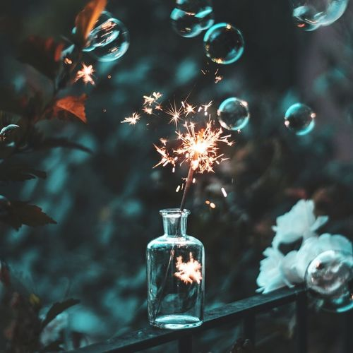 Lit Sparkler In Jar Amidst Bubbles