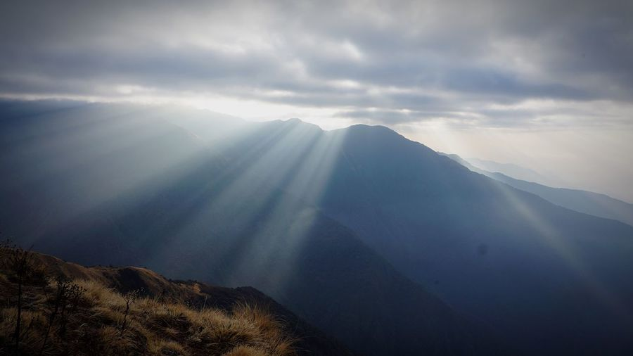 Determine Beauty In Nature Scenics - Nature Cloud - Sky Mountain Sky Tranquility Tranquil Scene Environment Landscape Nature Mountain Range No People Sunbeam Idyllic Majestic Sunlight Outdoors
