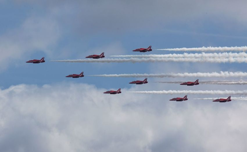 Red Arrows- Flying in formation. Teamwork Airshow Flying Sky Low Angle View Arrangement Cloud - Sky Vapor Trail Smoke - Physical Structure Airplane Formation Flying Air Vehicle Transportation Military Airplane Fighter Plane Skill  Mid-air Outdoors