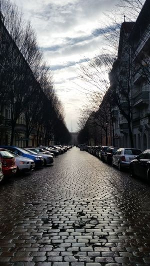 Myfuckingberlin Berlin Prenzlauerberg Berlindubistsowunderbar Fernsehturm Berlin  Streets Of Berlin Sky And Clouds Outdoors Nopeople Everyday KopfSteinPflaster Parked Cars Houses Sunday Afternoon Alley Of Trees Pattern Pieces Up Close Street Photography Capture Berlin The City Light Your Ticket To Europe Mobility In Mega Cities The Street Photographer - 2018 EyeEm Awards #urbanana: The Urban Playground