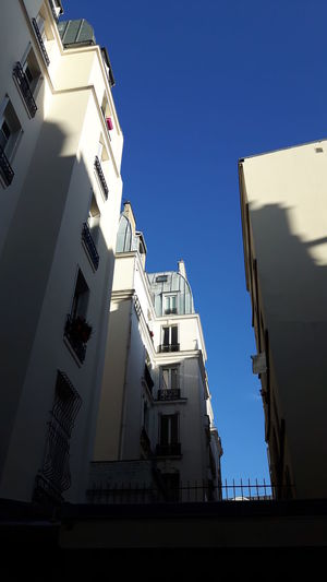 Paris, France  Sunlight White Building Blue Clear Sky Low Angle View Missing Blue Sky Sunlight And Shadow