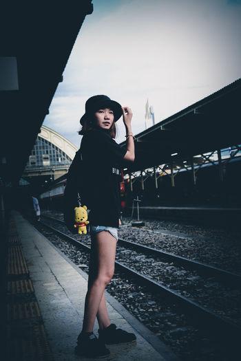 Full length of woman standing on railroad station platform