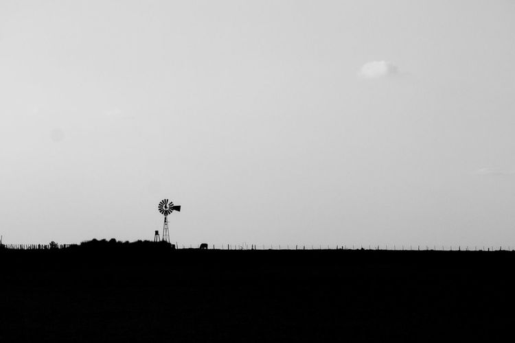 Scenic view of silhouette field against clear sky