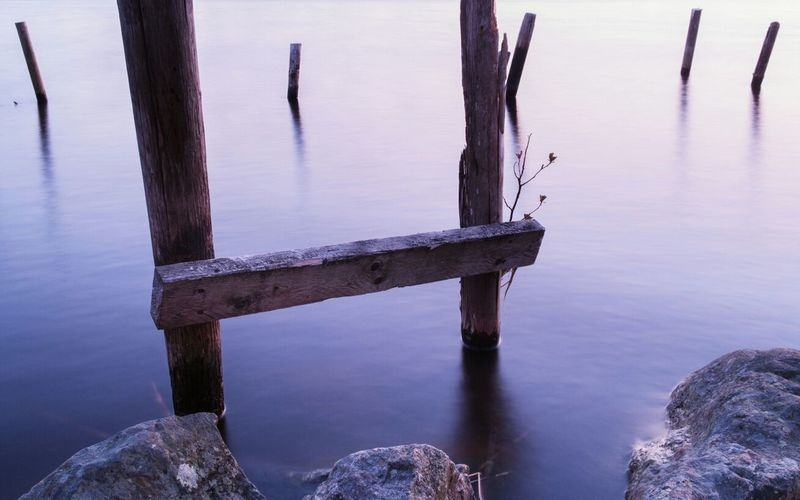 Wooden posts in lake