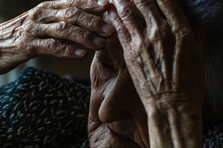 Close-up of old woman hand