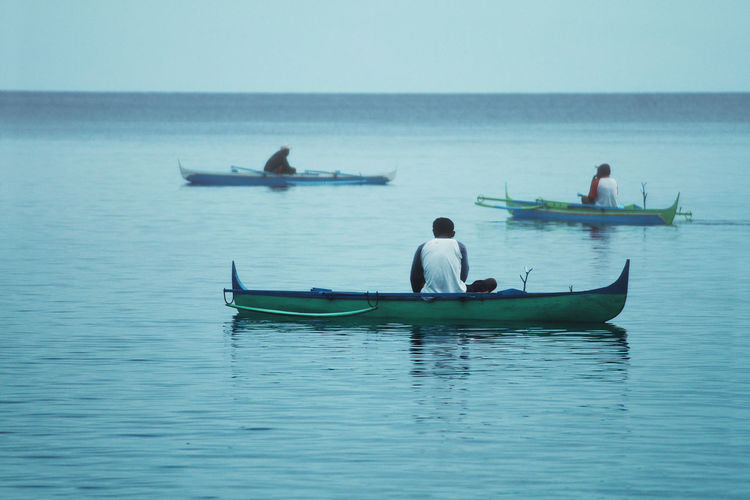 People boating on sea