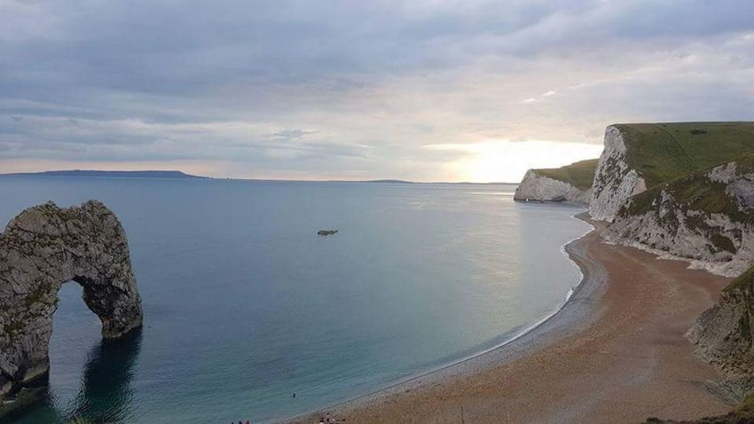 The Sun Setting on Durdle Door Durdle Door Travel Photography Beachphotography Beach Photography An Eye For Travel Beach Sea Water Sand Landscape Outdoors Reflection Tranquility Cloud - Sky Sunset Summer Travel Destinations Vacations No People Nature Day Horizon Over Water Sky Beauty In Nature Beauty EyeEmNewHere Go Higher Summer Exploratorium Summer Exploratorium