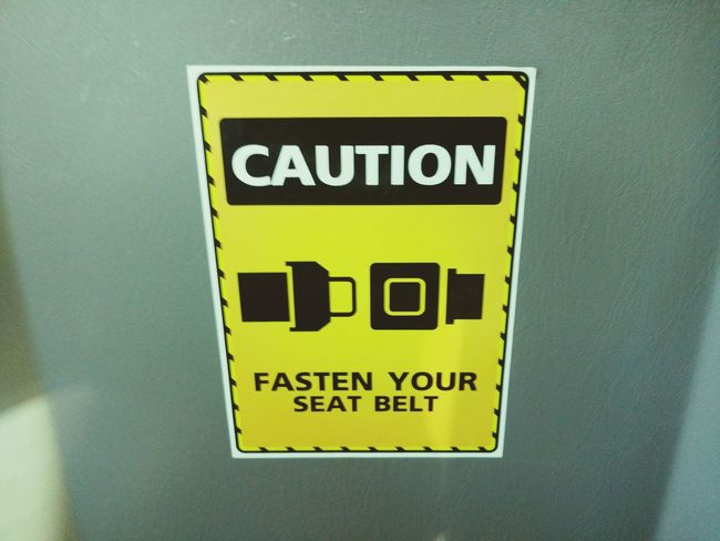 Seat belt caution. Yellow Text Close-up No People Outdoors Day