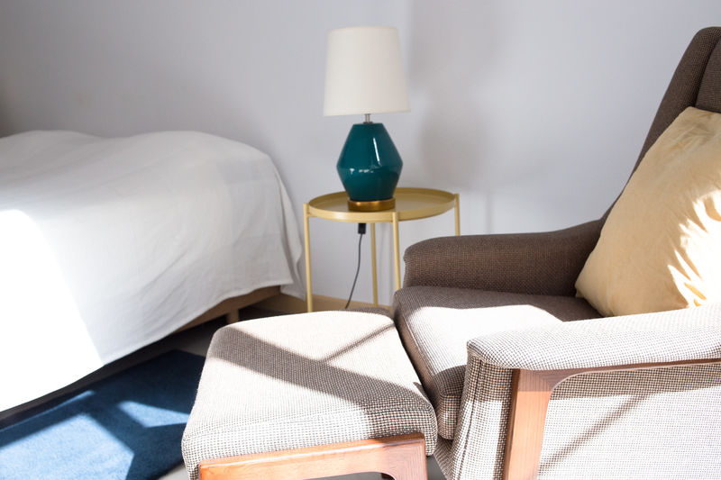 Sofa And Table Arranging By Electric Lamp At Home