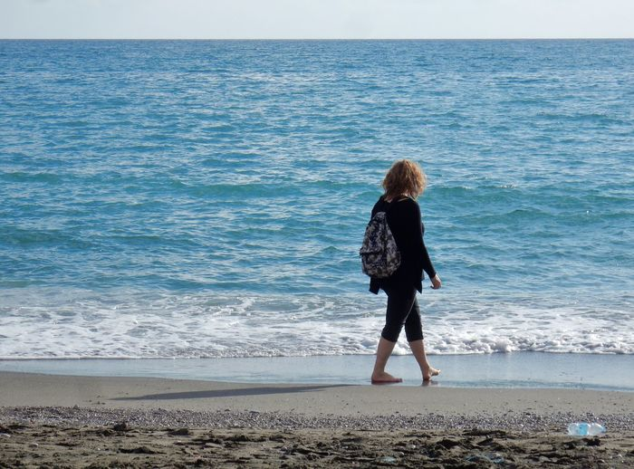 Sea Beach Water Land Horizon Over Water Beauty In Nature Full Length Sky Leisure Activity Horizon One Person Scenics - Nature Real People Standing Lifestyles Motion Nature Women Holiday Hairstyle Hair Outdoors Looking At View Amalfi Coast