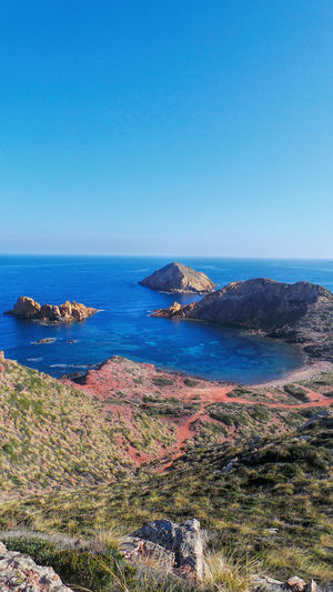 Sea Blue Horizon Over Water Water Beach Nature Sky Clear Sky No People Beauty In Nature Outdoors Travel Destinations Cliffs And Sea Cliffview Water Surface Menorca Redsand Wild Nature