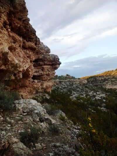cliff dweller Cliff Tree Mountain Desert Rock - Object Rock Formation Sky Landscape Cloud - Sky Natural Landmark Geology Rugged Canyon Extreme Terrain Physical Geography