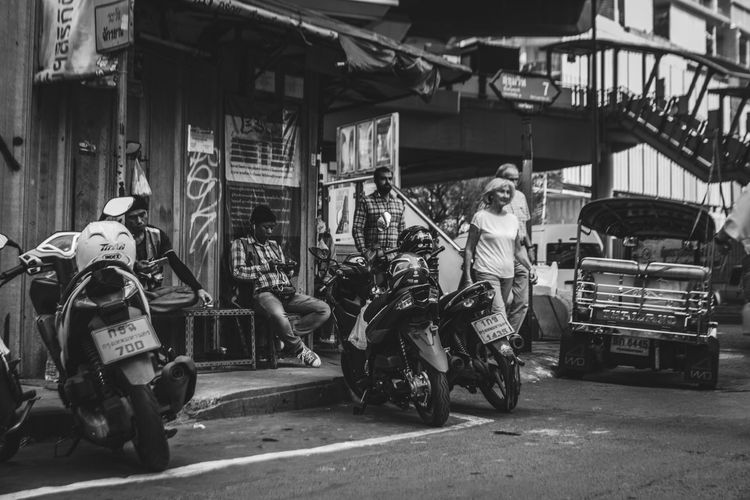The Street Photographer - 2018 EyeEm Awards Architecture Building Exterior Built Structure City Crash Helmet Day Driving Land Vehicle Men Mode Of Transportation Motor Scooter Motorcycle on the move Outdoors People Real People Ride Riding Road Scooter Street Transportation