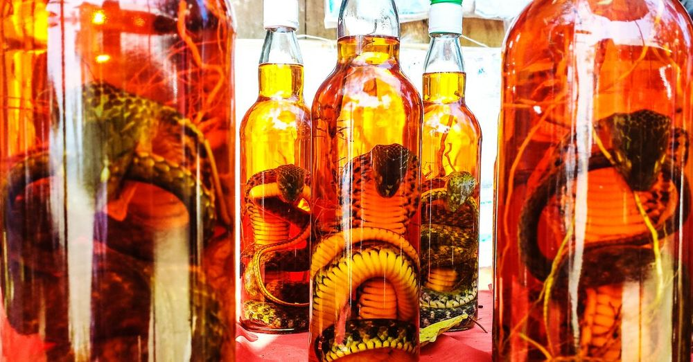 Close-up of cobra whiskey on table for sale in market
