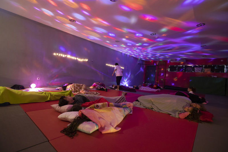 Portugal; Aula de Yoga Yogagirl Group Of People Illuminated Arts Culture And Entertainment Real People Large Group Of People Night Crowd Indoors  Enjoyment Women Lighting Equipment Dancing Leisure Activity Performance Lifestyles Light Men Music Adult Nightlife Stage Dance Floor Ceiling