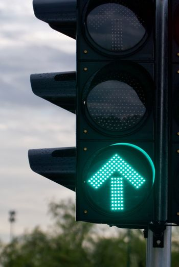 City Close-up Communication Direction Focus On Foreground Green Color Green Light Guidance Illuminated Light No People Outdoors Road Road Sign Road Signal Safety Sign Sky Stoplight Traffic Light  Traffic Lights Transportation