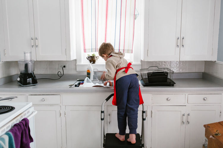 Boy working in kitchen at home