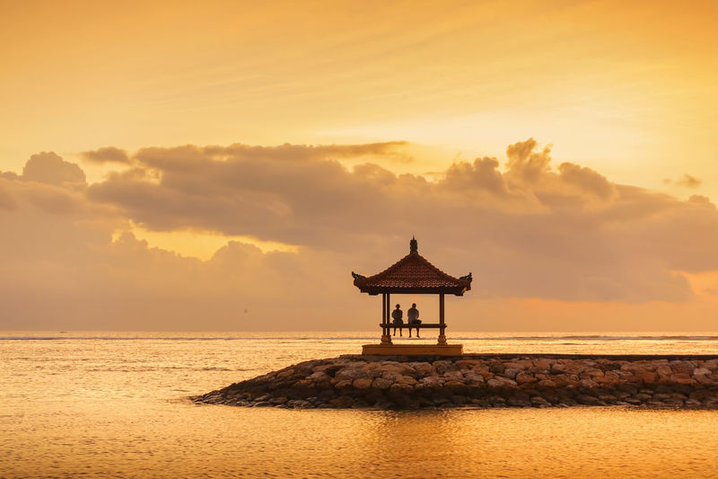 Beautiful Scenery at Karang Beach, Sanur, Bali, Indonesia INDONESIA Pagoda Relaxing Architecture Beach Beauty In Nature Built Structure Cloud - Sky Gazebo Horizon Horizon Over Water Land Nature No People Orange Color Outdoors Scenics - Nature Sea Silhouette Sky Sunrise Sunset Tranquil Scene Tranquility Water