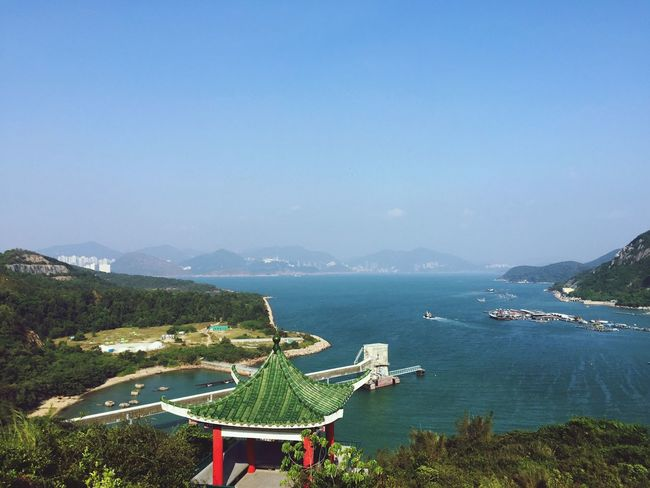 Mountain Water Beauty In Nature Nature Scenics High Angle View Day Outdoors Clear Sky Tranquility Sea No People Sky Mountain Range Blue Landscape Architecture Grass hong kong