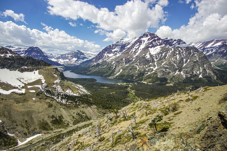 Scenic Point in Glacier National Park, Montana Beauty In Nature Cloud - Sky Day Landscape Montana Mountain Mountain Range Nature No People Outdoors Range Scenics Sky Snow Snowcapped Mountain Tranquil Scene Tranquility Water Winter