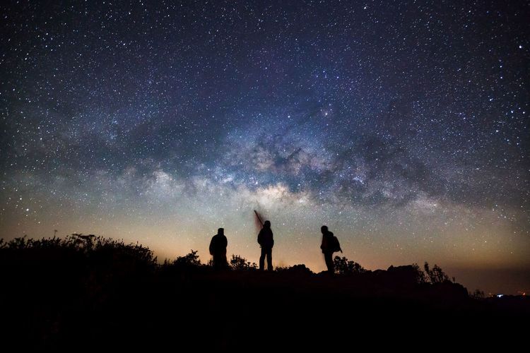 milky way galaxy Astronomy Beauty In Nature Galaxy Leisure Activity Lifestyles Low Angle View Men Milky Way Nature Night Outdoors People Real People Scenics Silhouette Sky Standing Star - Space Starry Togetherness Tranquil Scene Tranquility Tree Two People
