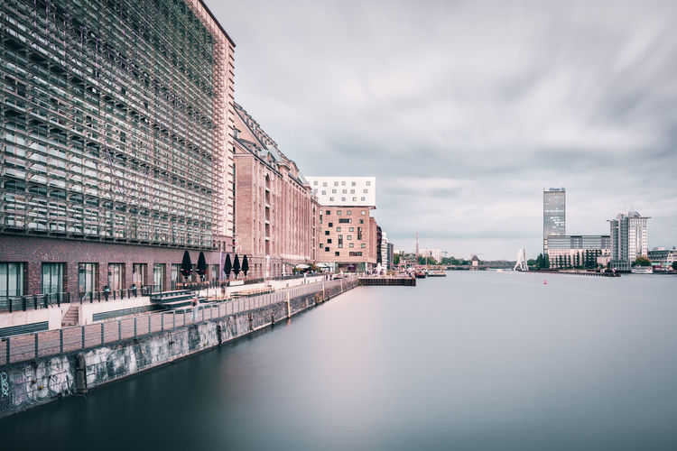 Mediaspree | Berlin, Germany 2016 Architecture Architecturelovers Berlin Berlin Friedrichshain Canal City City Life Cityscapes Cloudy Day Europe Germany Lifestyles Mediaspree Osthafen Berlin Outdoors Philipp Dase Sky Spree River Summer2016 Travel Destinations Treptowers Water Waterfront Weather