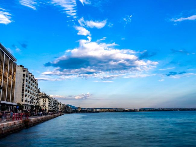 White cloud over a sea in a Greek town Thessaloniki Thessaloniki Greece Architecture Sky Built Structure Building Exterior Water Cloud - Sky Waterfront Nature City Building Sea Blue Outdoors Day Travel Destinations Beauty In Nature Scenics - Nature