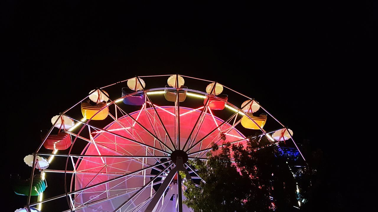amusement park, amusement park ride, arts culture and entertainment, ferris wheel, night, copy space, illuminated, sky, low angle view, no people, carnival, nature, clear sky, fairground, multi colored, traveling carnival, leisure activity, enjoyment, outdoors, fun, light, excitement