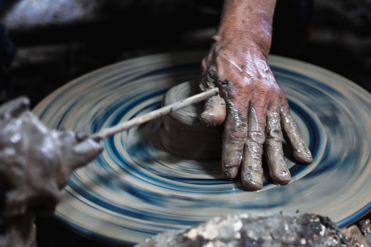 Man working on pottery wheel