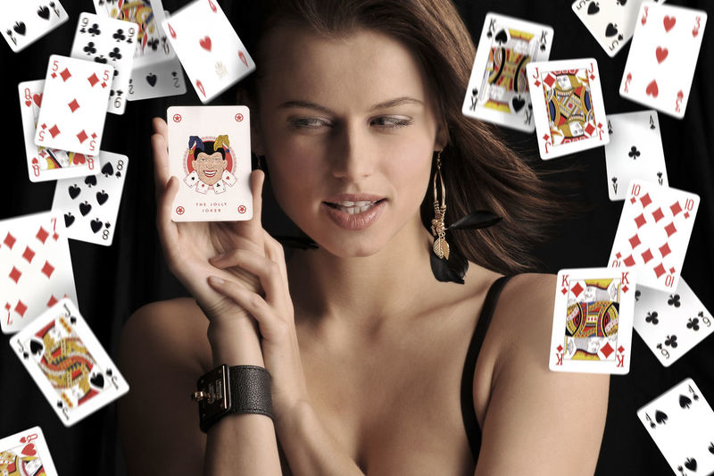 Close-Up Of Woman With Playing Cards