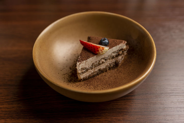 High angle view of cake in bowl on table