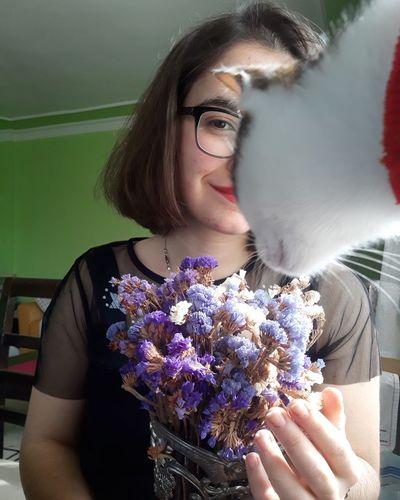 Portrait of beautiful woman holding flower bouquet